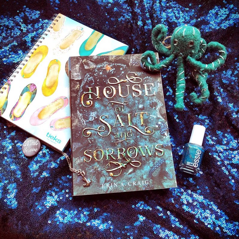 A picture of House of Salt and Sorrows on glitter