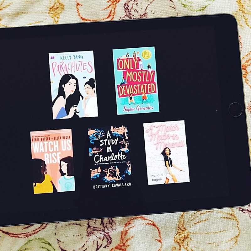 The covers of the recommended books are featured on an iPad, which is lying on a towel that has the outlines of orange and brown pumpkins.
