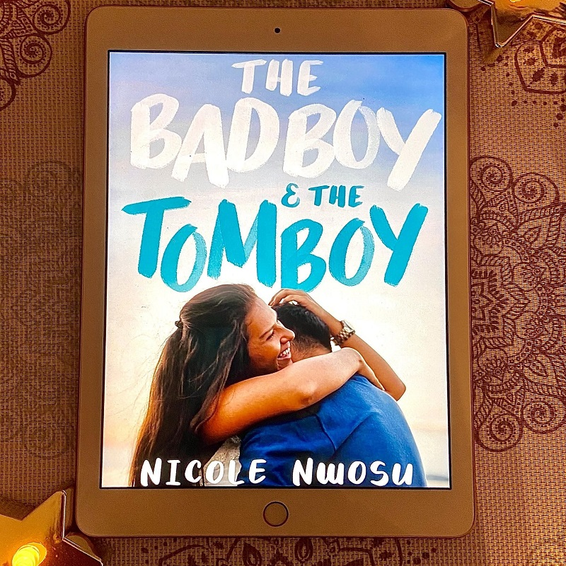 : A picture of The Bad Boy and The Tom bBoy book cover, and two star candles