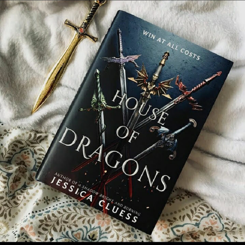 A copy of House of Dragons with a small replica dagger.