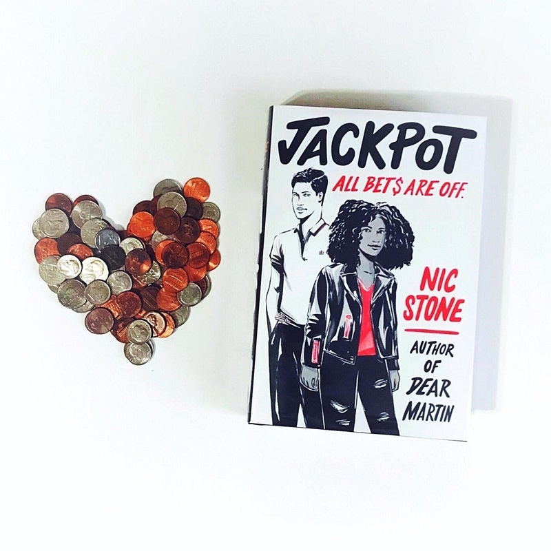 A copy of Jackpot sits on a white background with a heart made out of coins to its left.