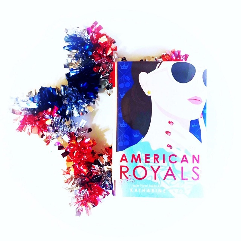 American Royals lying on a shiny, decorative red, white, and blue star