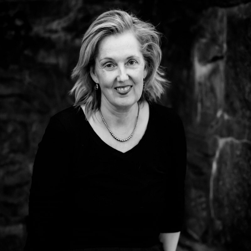 A black and white portrait of Sara O'Leary, author of her forthcoming novel, The Ghost in The House.